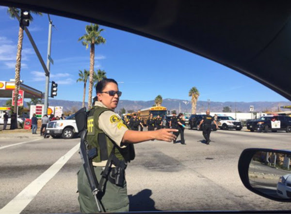 <div class='meta'><div class='origin-logo' data-origin='~ORIGIN~'></div><span class='caption-text' data-credit='mattgutmanABC/Twitter'>Armed officials unloading in San Bernardino.</span></div>