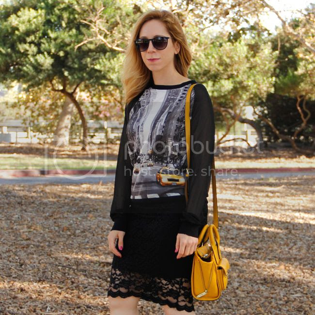 LA fashion blogger The Key To Chis wears an Elie Tahari for Kohl's georgette taxi top with a lace pencil skirt and Boohoo heels.