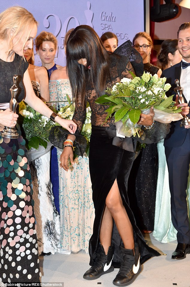 Steady on her feet: The star was presented with a huge bouquet of flowers