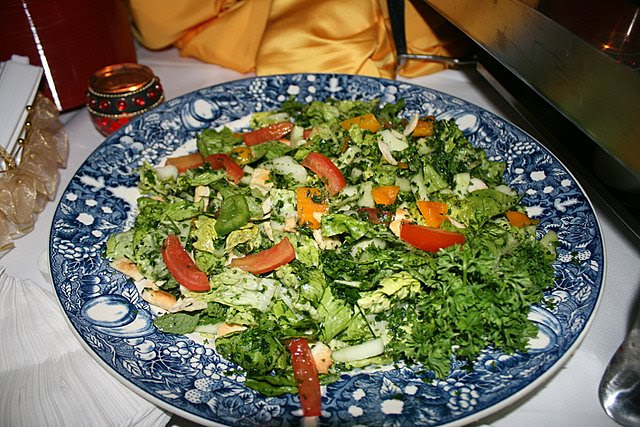 Fattoush salad with diced tomatoes, cucumber, capsicum, olive oil, sumac and pomegranate sauce