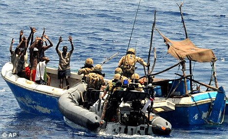 Royal marines board a suspected pirate vessel off Somalia last June
