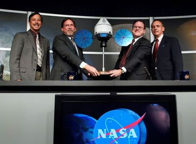 NASA management unveils a miniature mock-up of LOCKHEED MARTIN's Orion spacecraft
