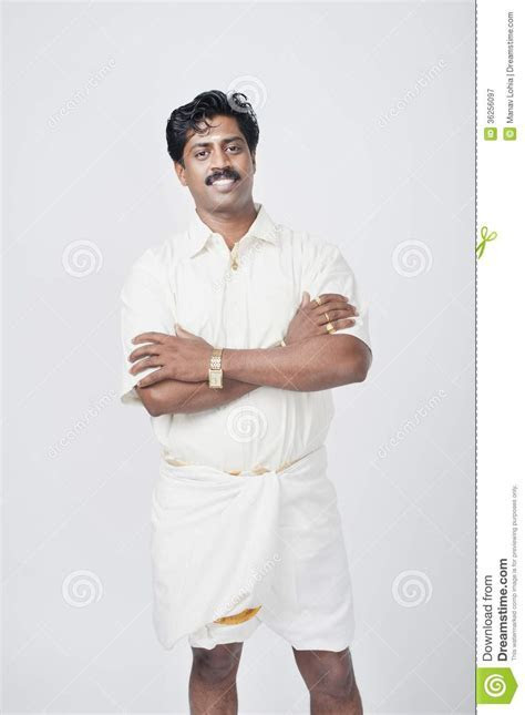 South Indian Man Standing With His Arms Crossed And