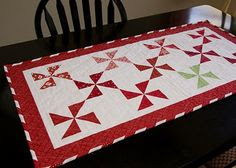 from the blue chair: Pinwheel Table Runner with Candy Cane Binding