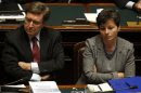 Enrico Giovannini sits next to Maria Chiara Carrozza at the Lower house of the parliament in Rome