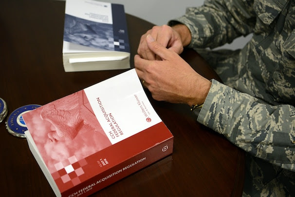 (Astrid Riecken/ For The Washington Post ) - Air Force Col. Kurt A. Bergo, director of contracting at Joint Base Andrews, speaks about the importance of using the Federal Acquisition Regulation manual.