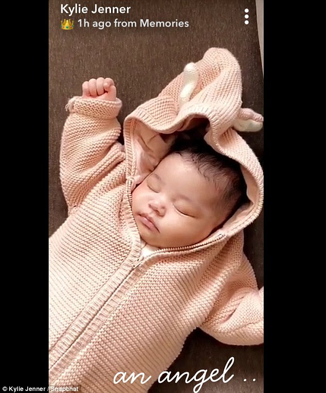 Her angel: Kylie has already shared several photos of her little bundle of joy. One had the baby in a light pink knitted zip-up hoodie jacket that had ears on the hoodie part.