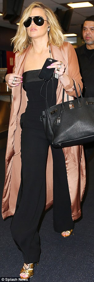 Running late? The star walked briskly as she headed to her terminal in the same outfit she wore to the event