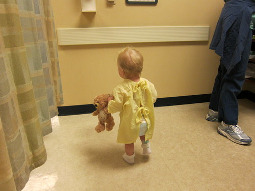 Miss M in Hospital gown with peeking diaper