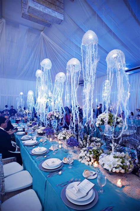 under the sea wedding motif with hanging jellyfish table