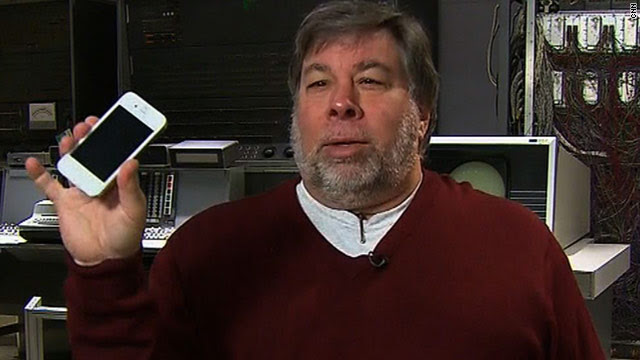Apple co-founder Steve Wozniak shows off his white iPhone 4, a much-anticipated model that still eludes average consumers.