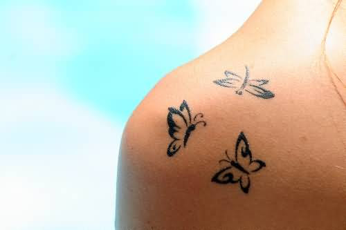 Simple Tribal Butterfly Tattoo On Womens Back Shoulder
