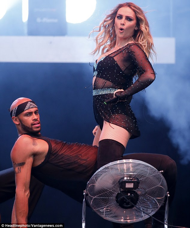 Tense: Perrie put her legs either side of the backing dancer as he supported himself on the floor