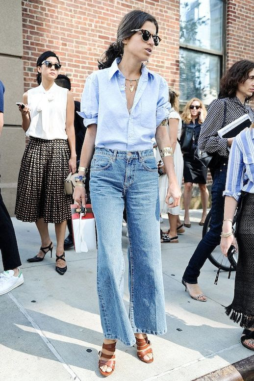 Le Fashion Blog Street Style Nyfw Sunglasses Blue Button Down Shirt Cropped Wide Leg Jeans Brown Strappy Sandals Stacked Gold Bracelets Via Popsugar