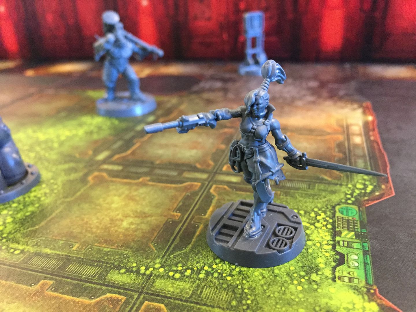 An Escher ganger strides into battle in Necromunda: Underhive.