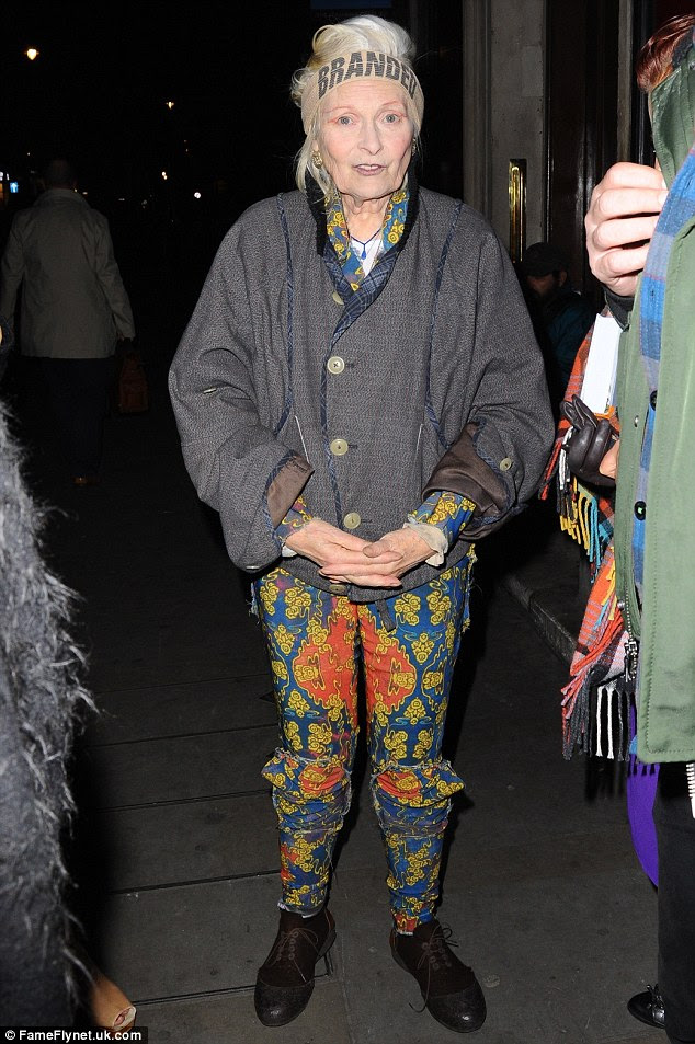 Quirky: Dame Vivienne kept up her interesting appearance - although her laces became untied