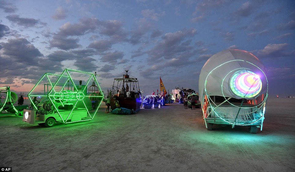Expressive in neon: Art cars lined up to be registered at the Black Rock DMV during the annual Burning Man event on the Black Rock Desert of Gerlach, Nevada on the eve of rain delays that followed Sunday into Monday