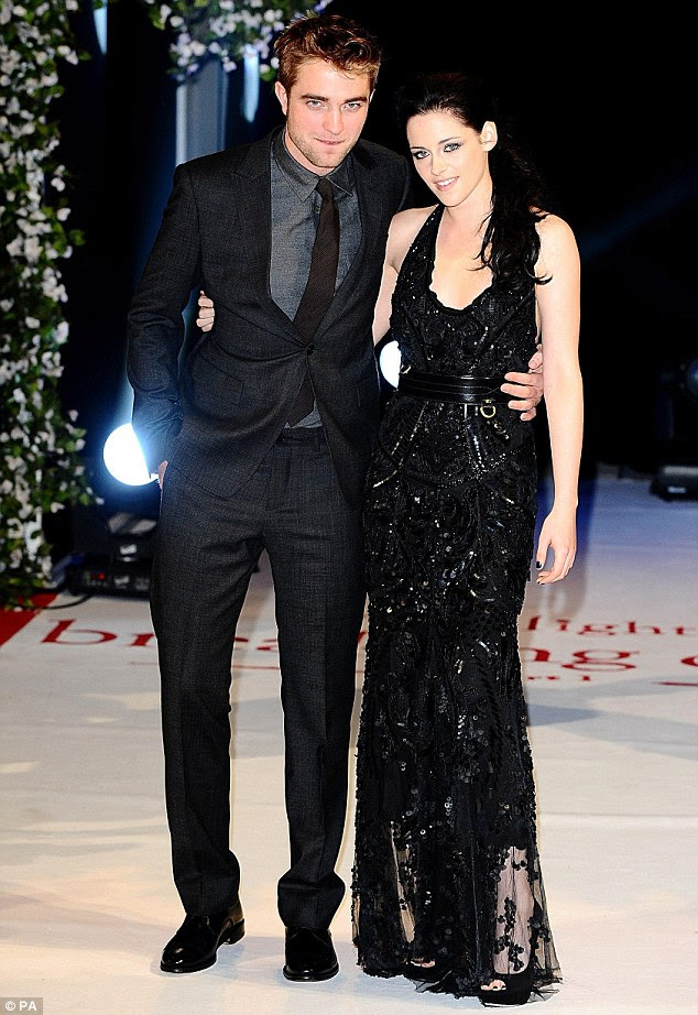 Star-crossed lovers: Robert Pattinson, and his on and off-screen leading lady Kirsten Stewart arrive at the UK premiere of Breaking Dawn in London tonight