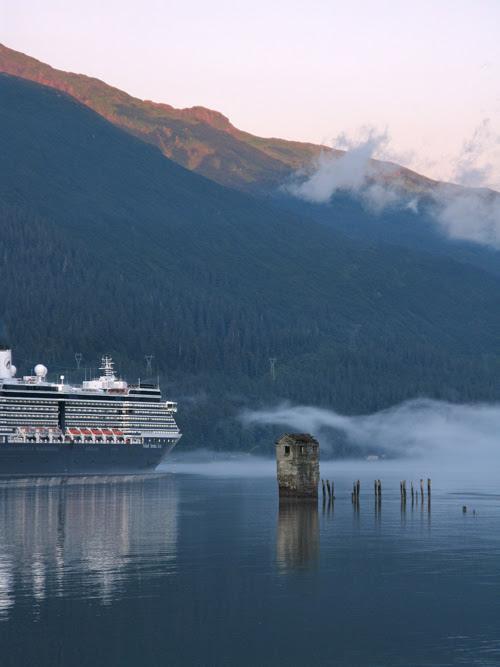 a cruise ship passes Sandy Beach in Douglas, as it heads down Gastineau Channel leaving Juneau, Alaska