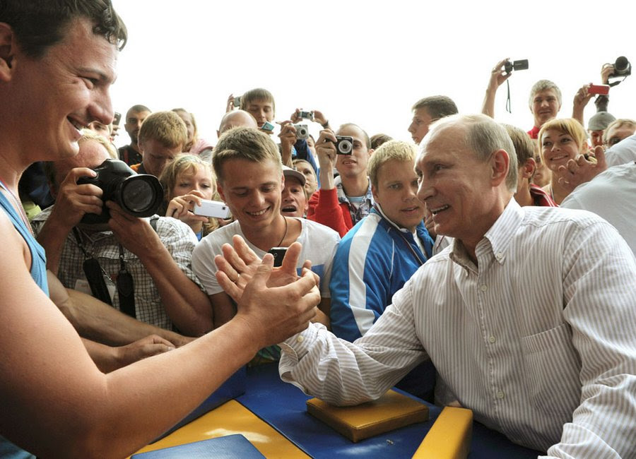 """Putin participates in competitions in weightlifting at the summer camp of the youth organization """"Nashi"""" at Lake Seliger in the center of Tver Region, August 1, 2011.  The camp brought together thousands of young activists from 84 regions of Russia."""
