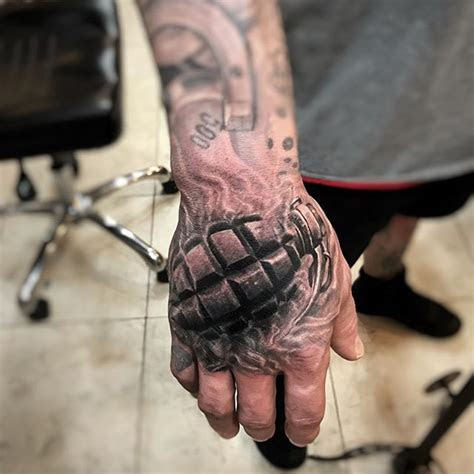 black grey hand grenade guillermo atguimorart