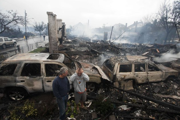 Residents look over the remains…