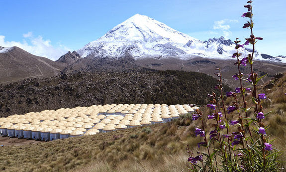 Water tanks for the HAWC detector with Picode Orizaba in the background.