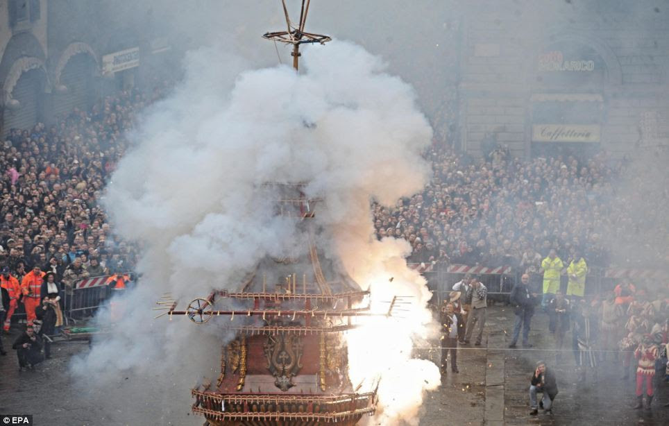 Explosions: Locals and tourists attend the  'Explosion of the Cart' folk tradition of Florence