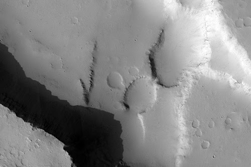 Faults and Channels on Elysium Mons