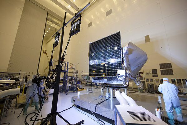 At NASA's Kennedy Space Center in Florida, an illumination test is conducted on one of OSIRIS-REx's twin solar arrays inside the Payload Hazardous Servicing Facility.