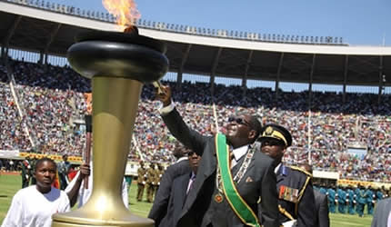 Republic of Zimbabwe President Robert Mugabe lighting the torch in Harare on the occasion of the 33rd anniversary of Independence. The event was on April 18, 2013. by Pan-African News Wire File Photos