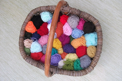 the wool basket by my little red suitcase