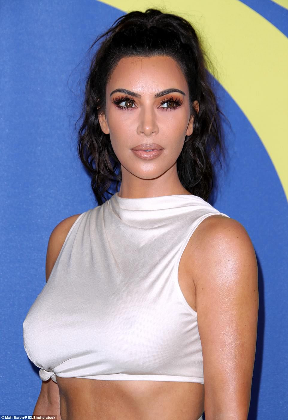 Bronze beauty: The KUWTK star was flawless with her long locks pulled up into a ponytail and showing off a bronze makeup look