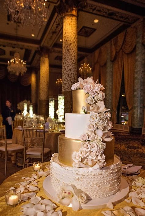 white gold and blush four tier wedding cake with cascading