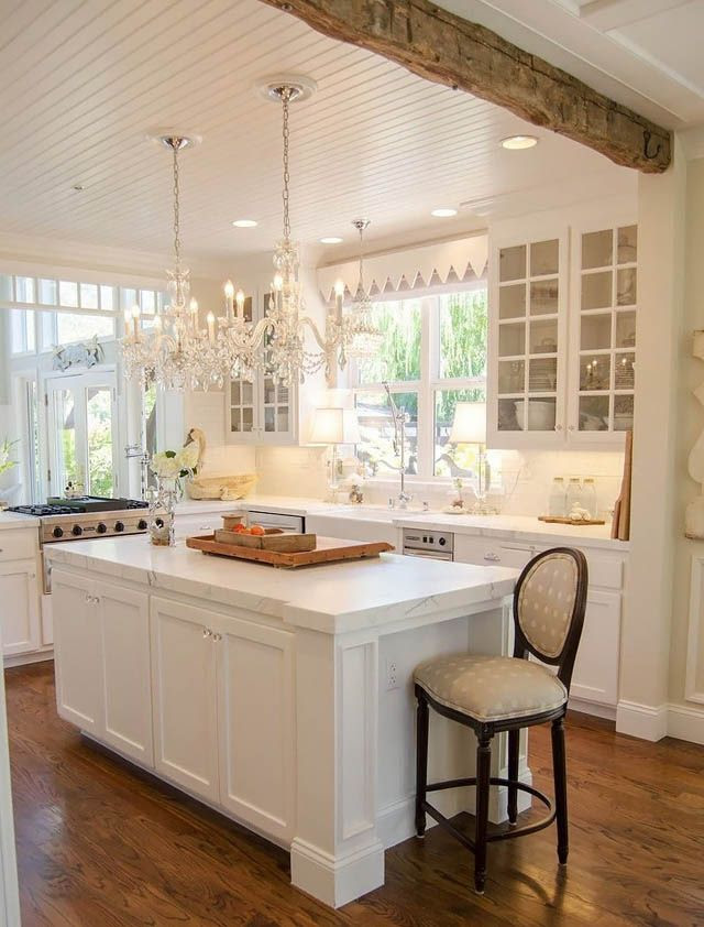 Chandelier in the kitchen - what an awesome idea!
