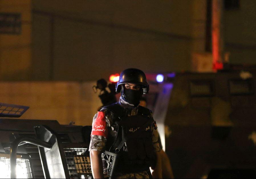 A policeman is seen near the Israeli embassy in Amman, Jordan July 23, 2017.