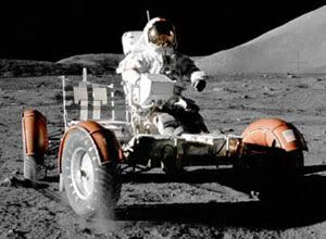 An Apollo astronaut cruisin' around on a lunar rover