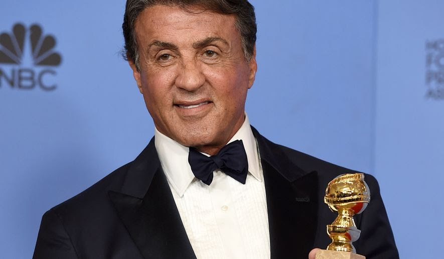 """Sylvester Stallone poses in the press room with the award for best performance by an actor in a supporting role in a motion picture for """"Creed"""" at the 73rd annual Golden Globe Awards on Sunday, Jan. 10, 2016, at the Beverly Hilton Hotel in Beverly Hills, Calif. (Photo by Jordan Strauss/Invision/AP)"""