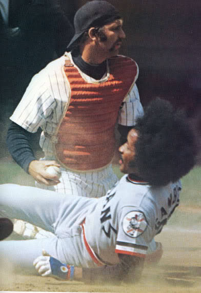 Yankee Catcher Thurman Munson tags out Oscar Gamble at home plate during a game against the Indians (1974)
