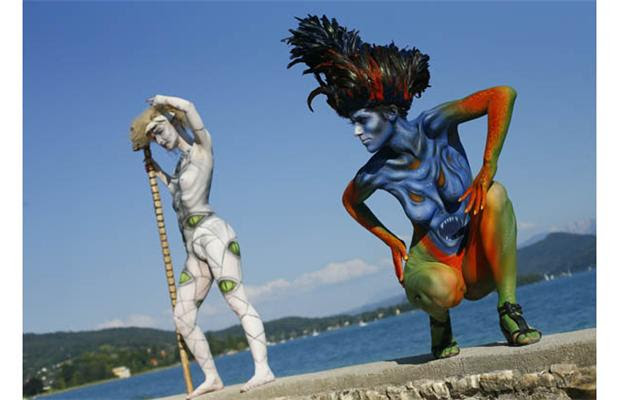 Participants pose with their body paintings during the 15th World Bodypainting Festival in Poertschach on July 7, 2012. Some 30,000 visitors are expected at the three-day event, with over 200 artists from 44 countries showing off their creations in the hope of taking home a prestigious World Award, the equivalent of a world championship title.
