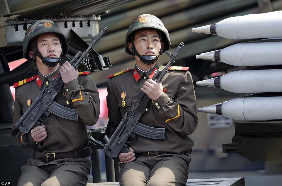 North Korean soldiers on mobile missile launchers as they are paraded across Kim Il Sung Square during today's military parade