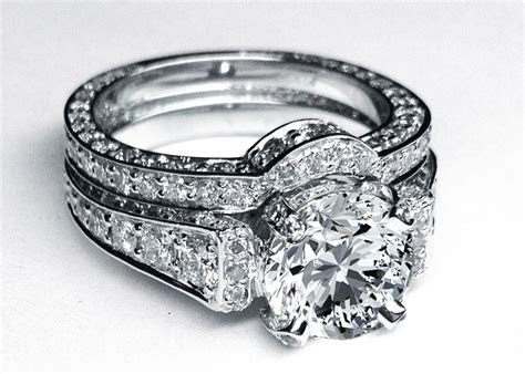 Large Round Diamond Cathedral Graduated pave Engagement