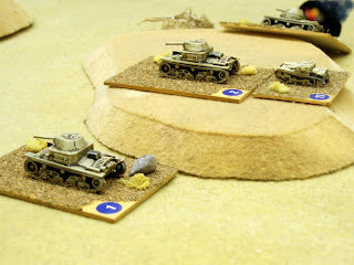 Italian M13/40s on the German right flank advance in the face of stubborn opposition