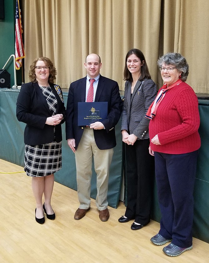 DAR Chapter Members presenting Kevin Cyron with the Outstanding Teacher of American History Award. Pictured, from left, are Chapter Registrar Wendy Stark, Outstanding Teacher Mr. Cyron, Chapter Regent Beth Boswell, and Chapter Historian Maureen Jenkins.