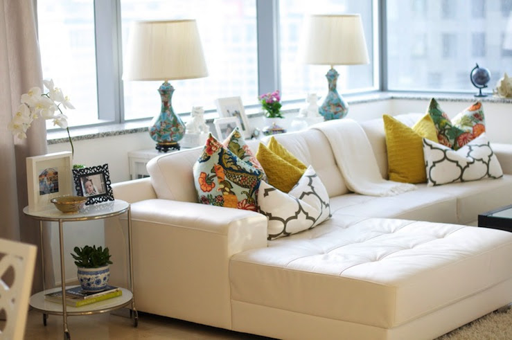 Suzie: Caitlin Wilson Design - Chic high rise living room design with white tufted leather sofa ...