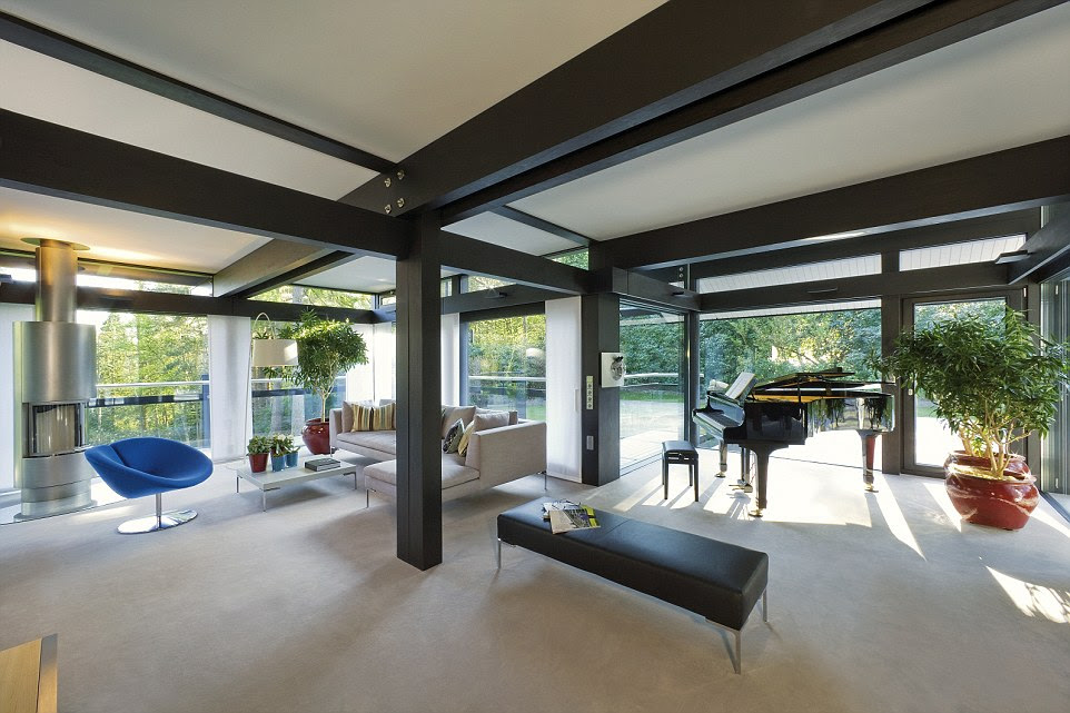 These  photos inside the actor's stunning home, taken before he moved in, showcase the enchanting property. The prefabricated home, by German building firm Huf Haus, is an impressive design feat in wood and glass - and it's eco-friendly, too