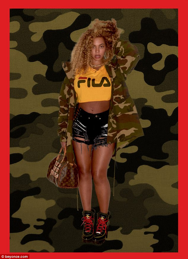 Sultry:Beyonce highlighted her toned legs in the edgy look, adding red laced boots and a Louis Vuitton handbag