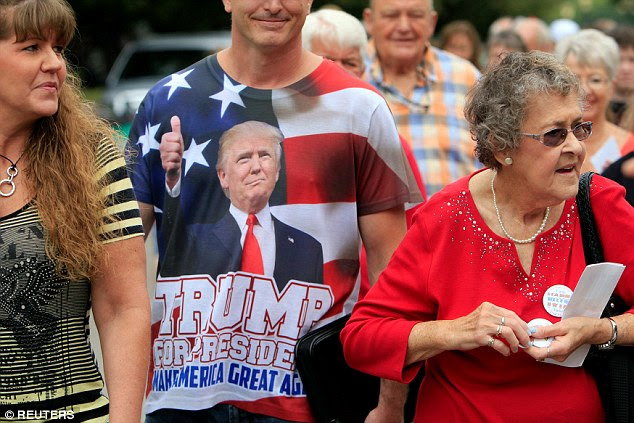 A supporter wears a t-shirt in support of Republican presidential nominee Donald Trump at Senator Joni Ernst's Roast and Ride at the Iowa State Fairgrounds in Des Moines