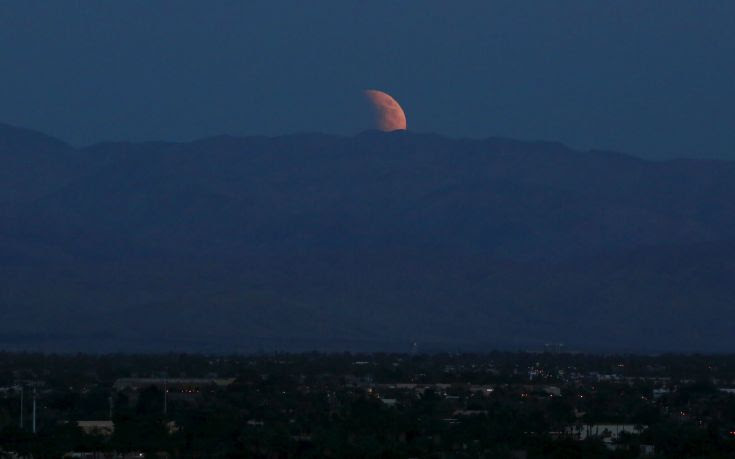 The bloodmoon is seen rising from the east over the Coachella Valley viewed from Palm Springs