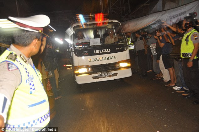 Ultimate price: An ambulance carries the bodies of drug smugglers executed by firing squads in Indonesia